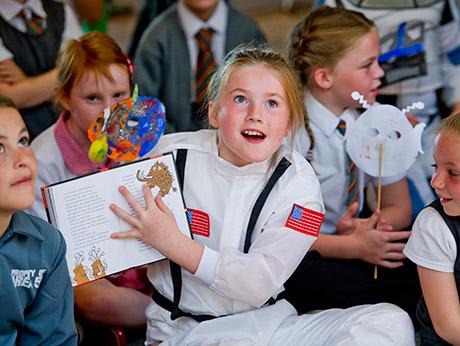 Children sharing a book
