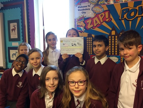 Pupils with picture book they created
