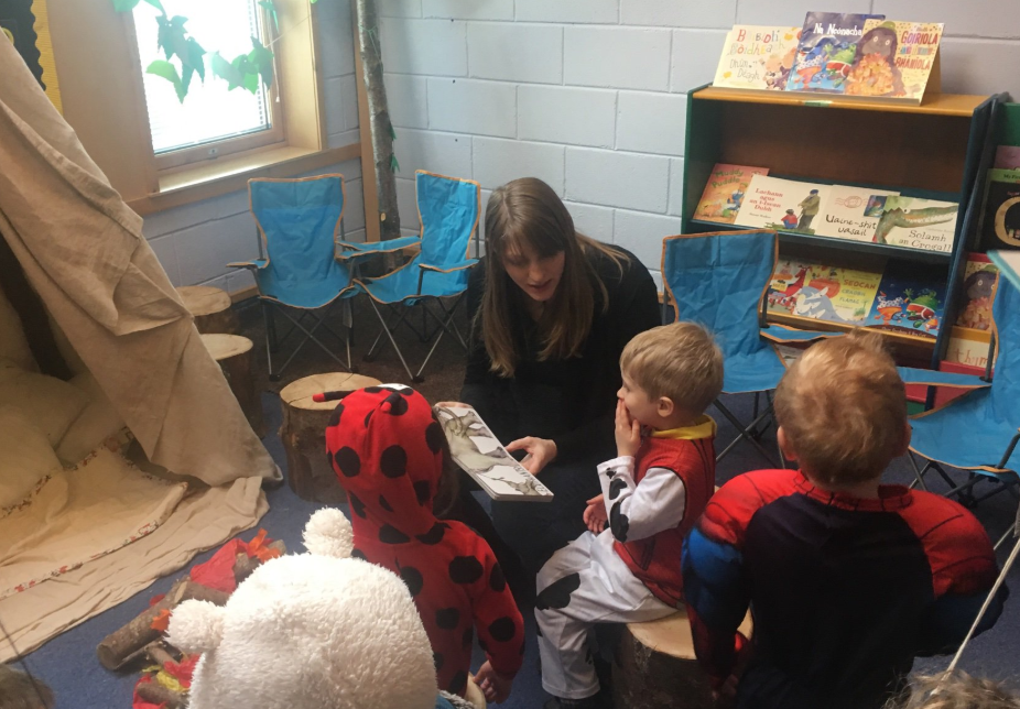 Pupils enjoying story in campsite reading area