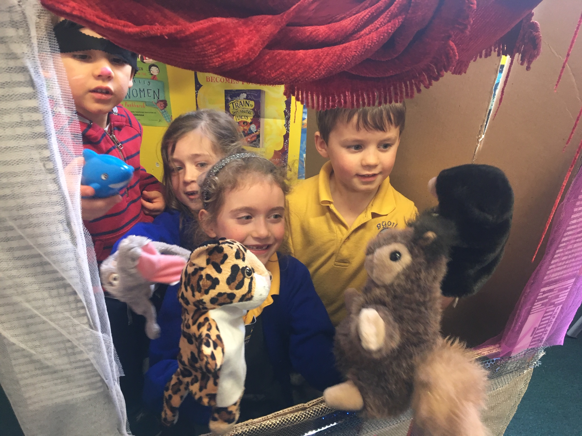 Pupils using puppets