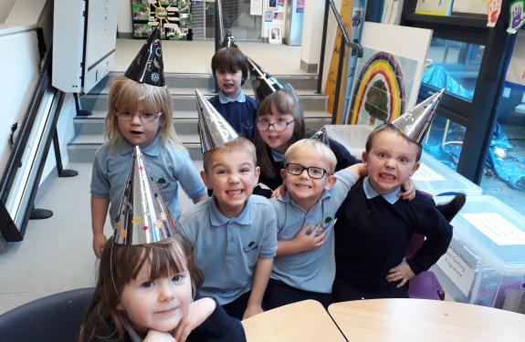 small children wearing wizard hats