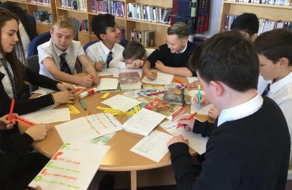 Secondary school pupils writing poems