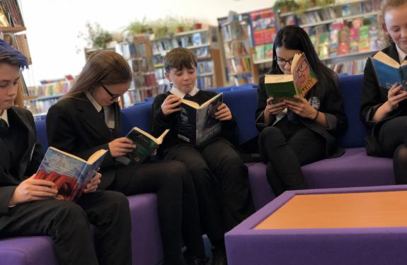 Pupils reading at St Andrew & St Bride's