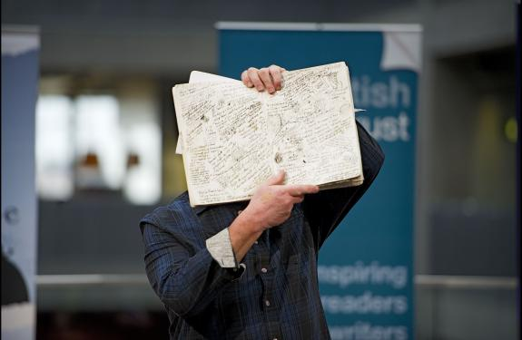 David Almond with notebook