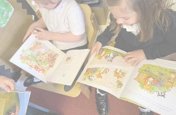 Two children with picture books open on their laps