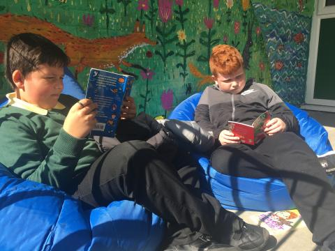 Knightsridge pupils reading outside