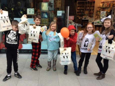 Students holding Waterstones bags