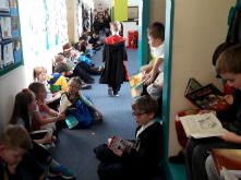 Children reading in the hallway