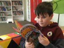 Boy reading comics