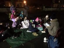 Reading around the campfire