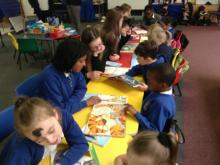 children looking at picture books